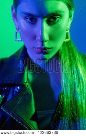 Color Light Face. Art Portrait. Duality Contrast. Mental Disorder. Bright Green Blue Neon Glow Confu