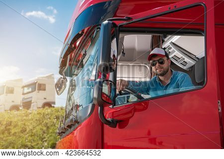 Happy Caucasian Truck Driver In His 30s Preparing Himself For Another International Haul. Heavy Duty