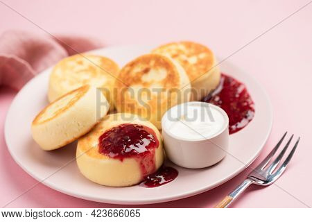 Syrniki, Cottage Cheese Fritters With Raspberry Jam And Sour Cream