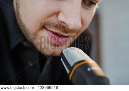 Close Up Of Influencer Podcast Creator Streaming Audio Broadcast At His Home. Broadcasting An Interv