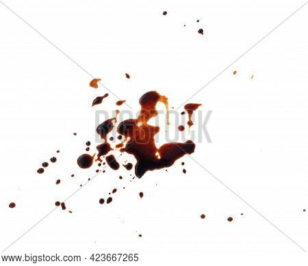 Spilled Black Coffee On A White Background. Large Brown Blot With Fine Splashes, Top View