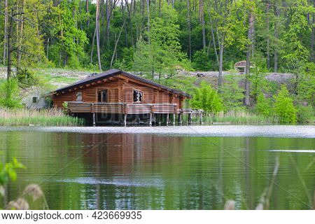Wooden House In The Forest Near The Lake. Quiet Place. An Old Wooden House For Rest Is On The Water.