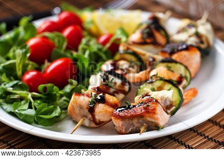 Fish Skewers With Mixed Salad. High Quality Photo.