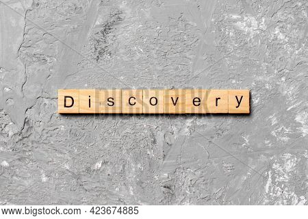 Discovery Word Written On Wood Block. Discovery Text On Table, Concept