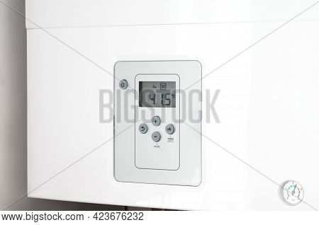 Electronic Panel Of A White Electric Water Heater.