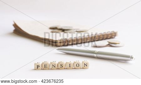 The Inscription Pension Next To A Notepad, Fountain Pen And Coins. The Concept Of Calculating The Si