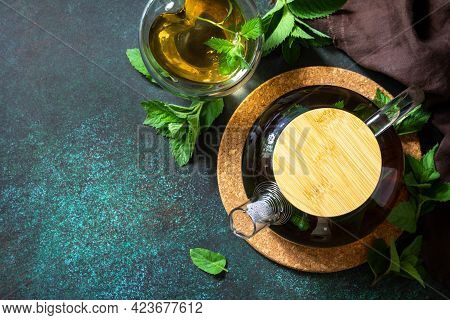Therapeutic Herbal Tea. Hot Mint Tea On A Dark  Stone Or Concrete Background. Top View, Flat Lay Bac