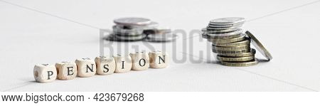 Pension Inscription Next To Many Small Coins. The Concept Of Calculating The Size Of The Minimum Pen