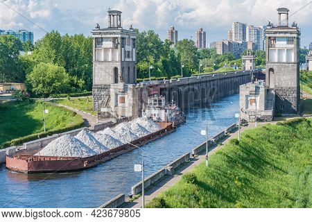 Freight Ship Moves Through The Gateway Of The River.