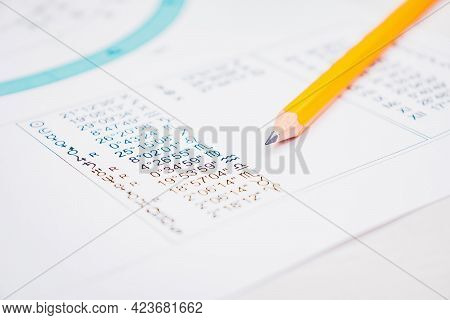 Modern Astrologer's Desktop. Yellow Pencil On The Table. Astrological Charts And Tables With The Coo