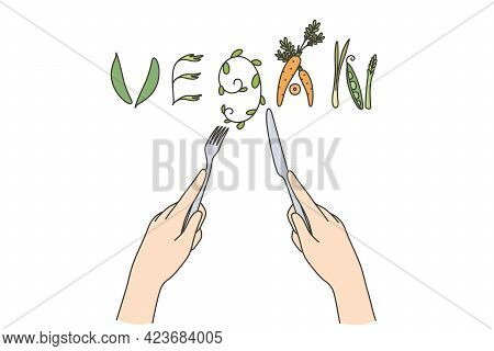 Vegan Food And Dieting Concept. Human Hands Forming Word Began Out Of Cutlery And Raw Natural Vegeta