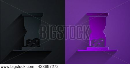Paper Cut Old Hourglass With Flowing Sand Icon Isolated On Black On Purple Background. Sand Clock Si