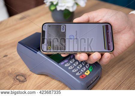 Alanya, Turkey - March 31, 2021: Man Hand Holding Iphone 12 Pro Max Gold With App Raiffeisenbank On