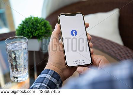 Alanya, Turkey - May 9, 2021: Man Hand Holding Iphone 12 Pro Max Gold With Social Networking Service