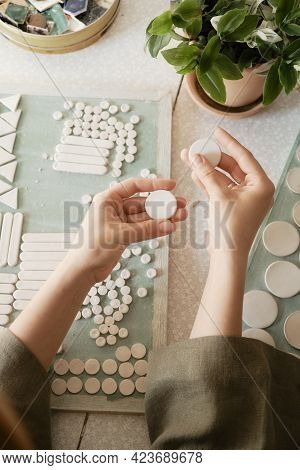 Girl Is Preparing To Create Ceramic Jewelry From Blanks.
