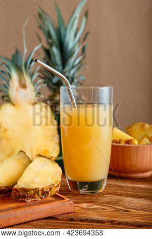 Pineapple Juice In Glass. Glass Of Fresh Natural Pineapple Juice Cocktail With Metal Reusable Tube O