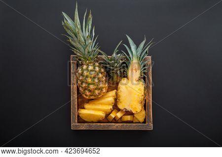 Sliced Pineapple. Bromelain Whole Pineapple Tropical Summer Fruit Halves Pineapple Black Dark Backgr