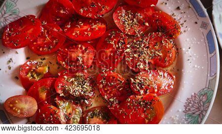 Ripe Cherry Tomatoes Served With A Pinch Of Oregano As A Side Dish