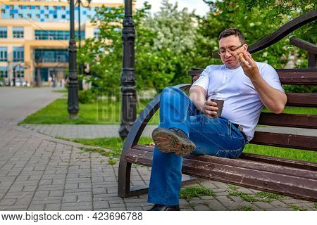 A Clumsy, Careless Person During Lunch, Sitting On A Bench In A City Park, Square, Spilled Tea, Coff