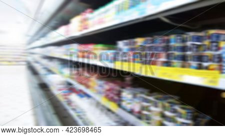Abstract Blur Image Of Supermarket Background. Defocused Shelves With Fresh Products For Sale. Groce