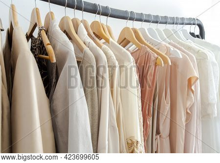 Stylish Womans Clothes Hanging On A Rack Natural Colors, Trending Concept,pastel Colors In White Roo