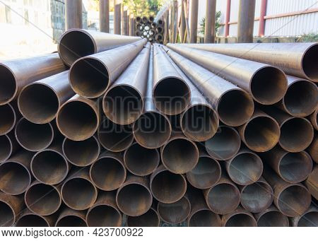 Water Pipes Stack. Metal Pipes Close Up. A Bunch Of Large Metal Pipes.