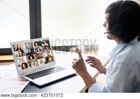 Intelligent Clever Indian Male Office Employee Making Video Call, Talking Ia Video Connect On The La
