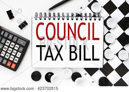Council Tax Bill. Notepad On A White Background Near The Chessboard, Checkers Of White And Black Col