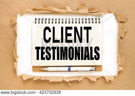 Client Testimonials. Text On Notepad Near Torn Paper