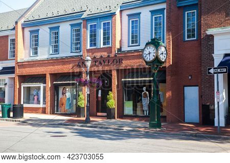 NEW CANAAN, CT, USA- JUNE 13, 2021: Empty Elm Street in Sunday morning with store fronts