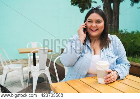 Young Plus Size Woman Talking On The