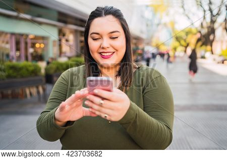 Young Plus Size Woman Using Her Mobile
