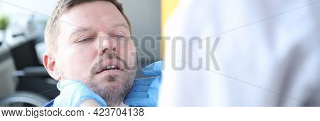 Doctor Examines Patients Thyroid Gland In Medical Office