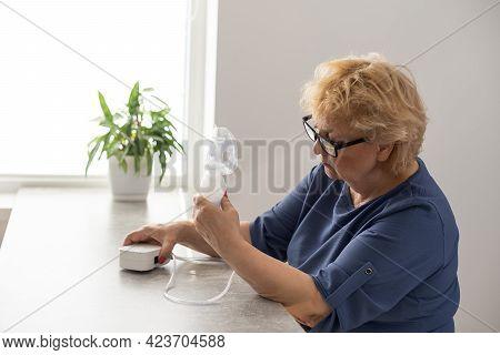Sick Elderly Woman Making Inhalation, Medicine Is The Best Medicine. Ill Senior Woman Wearing An Oxy