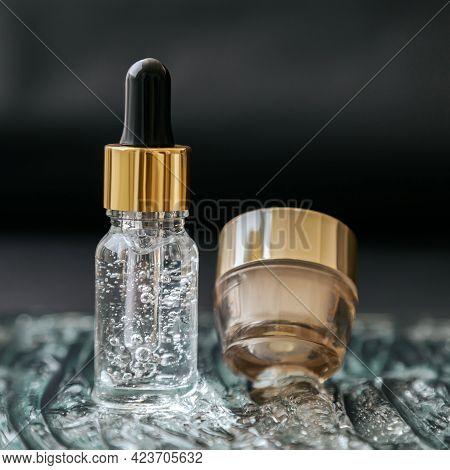 Skincare Cosmetic Serum Bottle With Fluid Collagen Hyaluronic Acid, Moisturizer Cream Jar On Water G