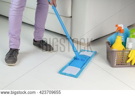 Housemaid Cleaning Floor In Room Close-up.woman Doing Chores.