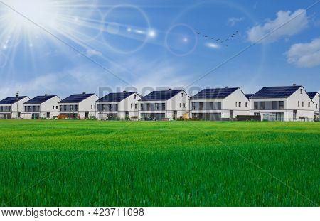 Row Houses With Solar Panels. Green Renewable Energy.
