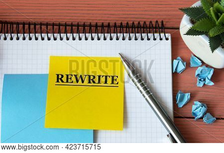 Rewrite - Word On A Note Sheet With A Cactus In The Background. Info Concept
