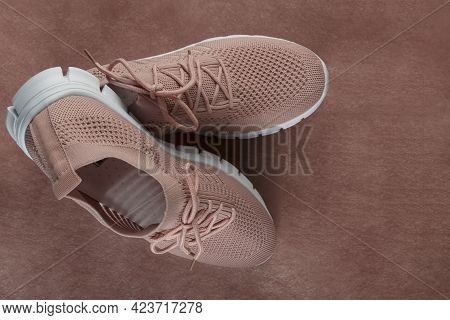 Pink Women's Shoes Made Of Light Soft Fabric. Shoes Lies On A Light Brown Background