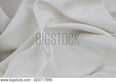 Closeup of rippled white silk fabric lines