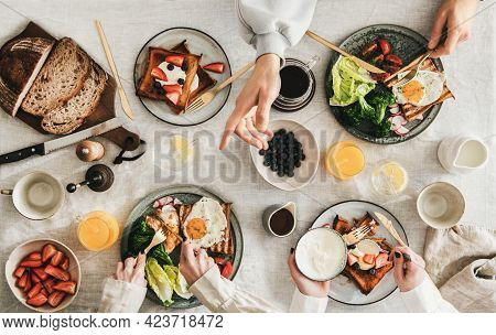 Group Of People Friends Having Breakfast Or Gathering Brunch