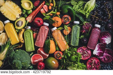 Fresh Natural Colorful Organic Juices Over Fruits Vegetables Berries Background