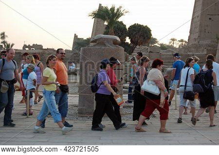 Luxor, Egypt - January 5, 2006: Tourists Walking Around An Ancient Egyptian Sculpture Of A Scarab Be