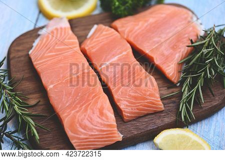 Fresh Salmon Fish, Raw Salmon Filet With Lemon Rosemary Herbs And Spices