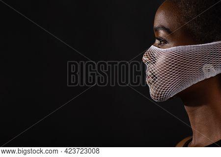 Portrait Of African American Dark Skin Woman Fashion Model Wearing Quarantine Medical Fishnet Knitti