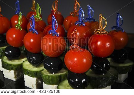 Many Beautiful Canapes On Skewers Close Up