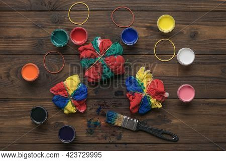 A Large Number Of Fabric Paints And Brushes With Fabric On A Wooden Background. Staining Fabric In T