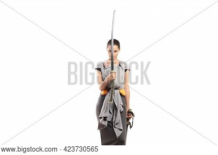 Babywearing Attractive Young Mother With Baby In Carrier. Holding A Japanese Sword. Mother Protectio