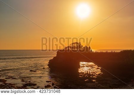 Silhouette Of Pura Batu Bolong In Golden Sunset It The Traditional Balinese Temple Located On A Rock
