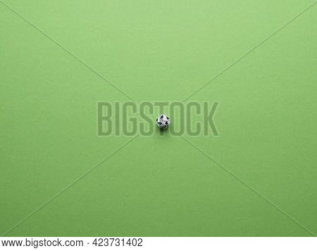 Soccer Field, View From Above, Crumpled Paper Ball As A Soccer Ball On A Green Paer Background As La